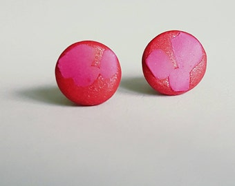 Raspberry and hot pink coloured clay stud earrings.