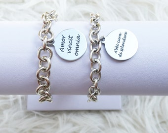 Bracelet made of aluminum or stainless steel balls and stainless steel plate with inscription