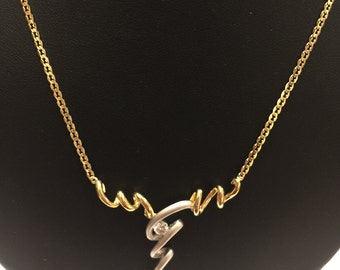 18k Yellow & White Gold Necklace with tension set Diamond. Lightning look design necklace.