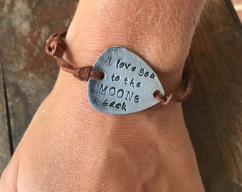 I love you to the moon and back - Antique Distressed Brass Guitar Pick Hand Stamped Bracelet Natural Brown Leather Cord Adjustable 6""