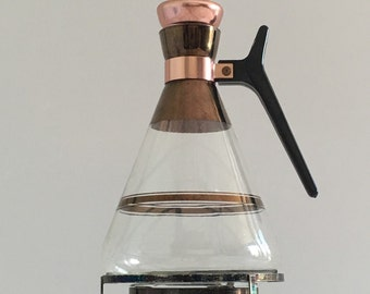 Vintage midcentury modern coffee carafe with heating stand