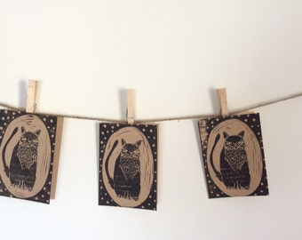 "Set of four hand-printed ""FAT CAT"" cards"