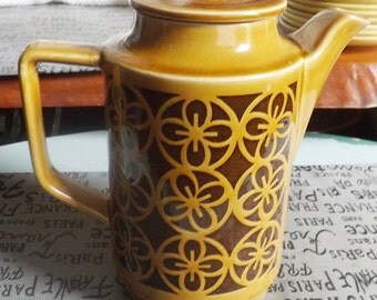 Vintage (c.1970s) stoneware coffee pot with lid. Made in Japan. Retro embossed geometric pattern.  Mustard with brown details.