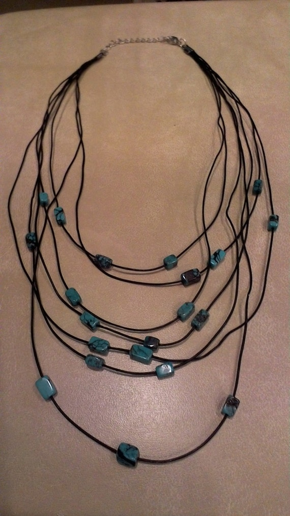 necklace made of black or brown leather cord and turquoise beads