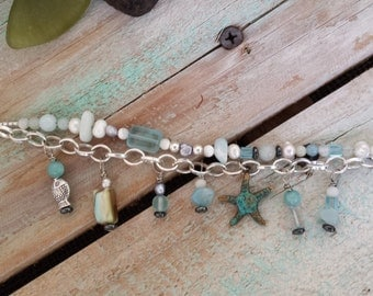 Sea-Inspired Double-Strand Bracelet with Pearls and Brass Patina Starfish Charm