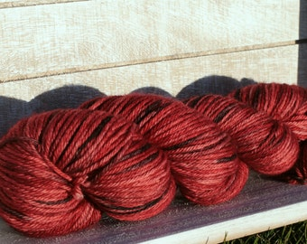 Hand dyed worsted weight yarn in red and black Arizona Cardinal coloryway, Indie yarn in a worsted weight wool, Merino superwash wool dyed
