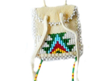 Medicine bag made of deerskin with glass beading to the repositioning
