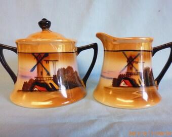 Art Deco lustre ware milk jug & covered sugar bowl. made in Japan by Chikaramachi . c.1925. windmill scene. perfect condition.