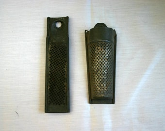 Two (2) small, metal graters.  Would have been used for zesting food. Now more as decoration.  Great Patina.