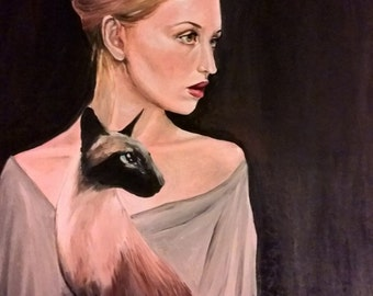 Woman with a siamese cat