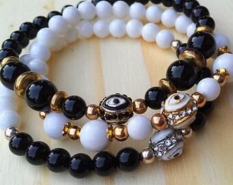 Onyx or White Jade Evil Eye Bracelet
