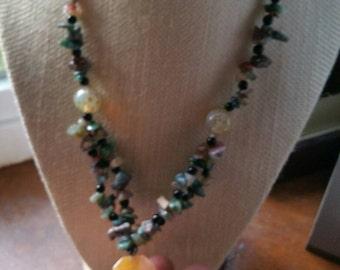 Multiple gemstone necklace with tassel