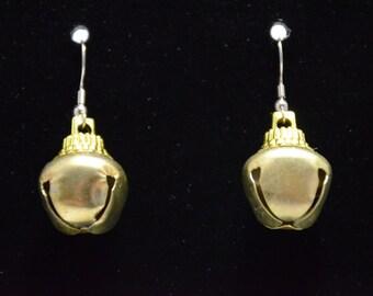 Festive gold bell earrings.