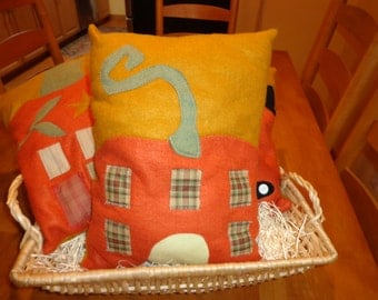 Pumpkin pillow with house and vine. Perfect for Halloween and Thanksgiving decorating.
