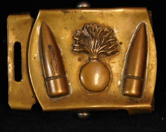 WWll Ordinance belt buckle, solid brass, kind of squished