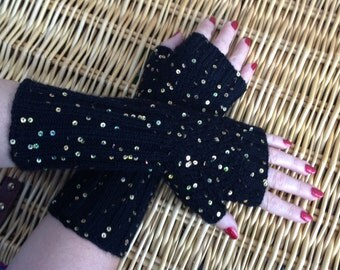 Fingerless gloves; wrist warmers; mittens. Black with gold sequins.