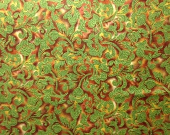 Rust-Colored Design on Green Background
