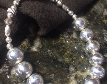 Silver 10mm beads with accent beads and toggle clasp