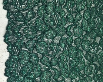 4 way stretch dark green metallic lace with scallop edge on both sides
