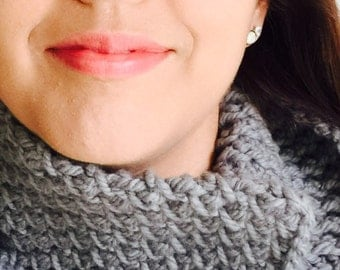 Cowl with a red button