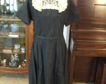 Late 40's/early 50's black taffeta w/ white cotton lace color and trim.