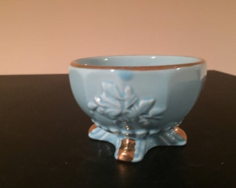 Gorgeous light blue vintage dish made in Japan lined with roses and etchings.
