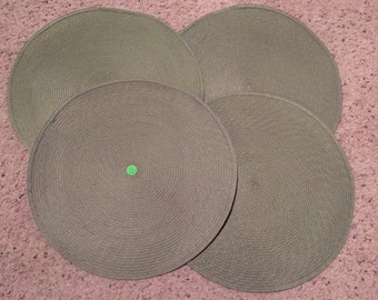 Handwoven place mats or plate chargers is sift greenish gray