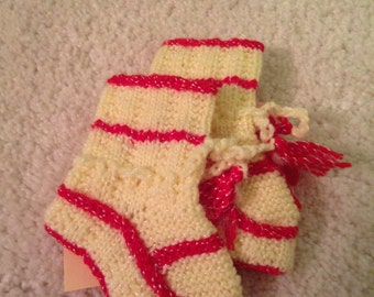 Super cute knitted red and cream baby or dolly socks