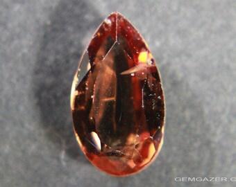 Reddish-orange Spinel, faceted, Sri Lanka.  1.76 carats.