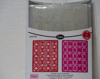 A set of two embossing folders from Cuddle Bug