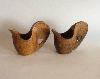 Two handcarved wooden jugs, bird shaped