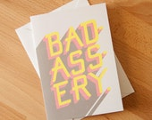 Badassery Greeting Card with envelope. Hand lettered illustration. Grey, pink, and yellow. Shadow design.