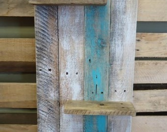 Decorative three level shelf made from pallet wood and or barn wood.