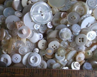 Huge vintage/old button lot of shades of white, creams, clear.