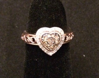 10k rose gold heart shaped ring with white and chocolate diamonds.