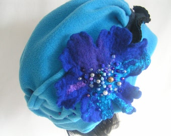 Winter fleece hat, with handmade felt and glass beads.