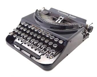Remington junior typewriter, 1930's, black, made in USA, working typewriter, portable typewriter, collectors item, 4 bank typewriter.