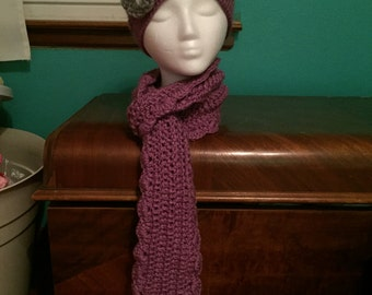 Purple crocheted hat and scarf