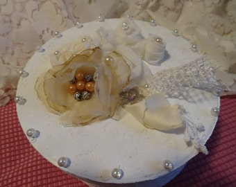box dressed round lace and fabric flowers