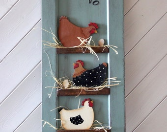 Co-Co-Co: three chickens in a cute chicken coop