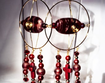 Red beaded and gold colored hoops