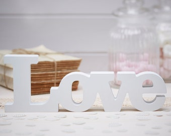 The word love in white wood