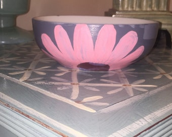 Grey ceramic dining bowl with pink flower on the face
