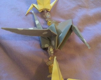 grey and yellow single strand origami crane mobile