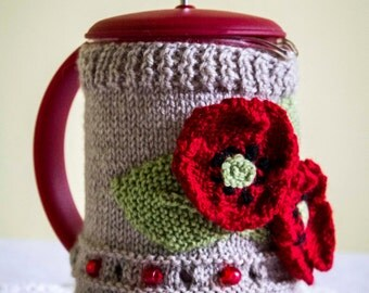 Hand Knitted Coffee Pot cost with poppy detail.