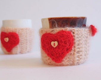 Knitted cup cozy with a heart