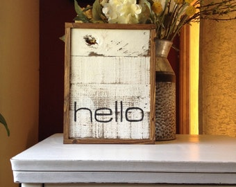 Rustic white hello sign on pallet wood