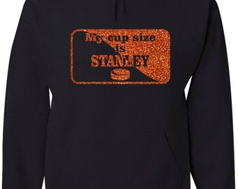 Black hood sweatshirt with My cup size is Stanley and hockey puck design
