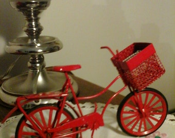 Red bicycle with a basket