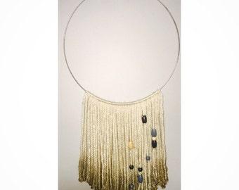 Yarn and ring wall decor